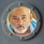 Zissou looks through porthole in Life Aquatic
