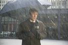 Nicolas Cage in The Weather Man, umbrella in rain