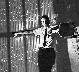 Melvin Schwartz next to a spark chamber